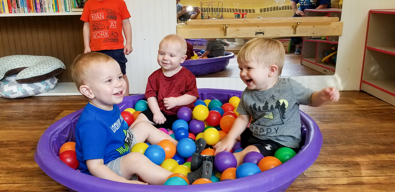 "Toddlers and infants enjoyed playtime together in the ball ""pit""."