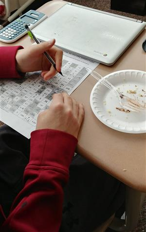 Student working on calculations for Pi Day.